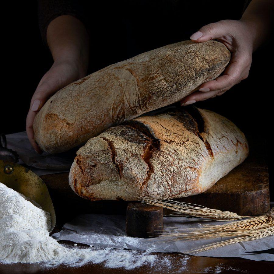 Bread Loaf In Baker Hands